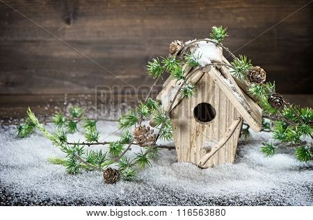 Birdhouse And Christmas Tree Brunch Decoration In Snow