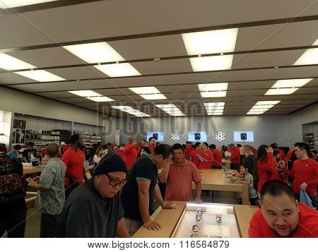 People Look At Watch And Other Products At The Apple Retail Store