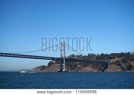 Bay Bridge, Yerba Buena Island And Boat Sailing Under