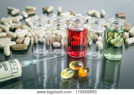 Small Bottles With Pills Along With A Syringe, Concept Of Sanitary Copayment