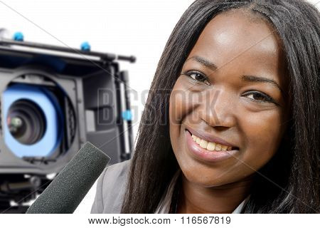 Young African American Journalist With A Microphone And Camera