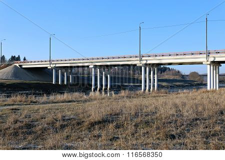 The Long Bridge On Piles Over The River