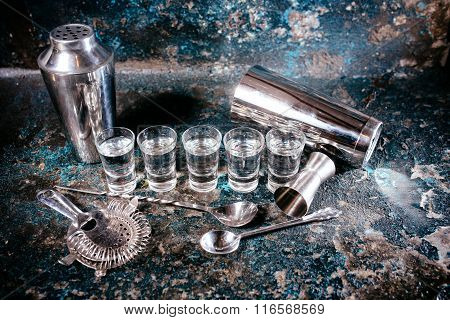 Bartending Tools With Cocktail Shaker, Shot Glasses And Alcoholic Drinks. Bar Details, Nightlife
