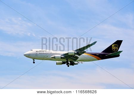 HONG KONG - JUNE 04, 2015: UPS Boeing 747 landing at Hong Kong airport. United Parcel Service, Inc. (UPS) is the world's largest package delivery company