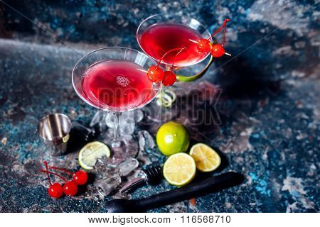 Cosmopolitan Alcoholic Cocktail Drink At Casino And Bar Served With Lime, Ice And Cherries