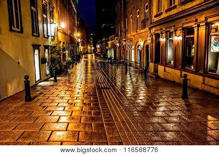 Quebec City Quebec Canada - Sept. 9 2015: Night brings a romantic character to the old stone buildings of historic Quebec City. Founded in 1608 Quebec remains a walled fortress and a UNESCO World Heritage Site.