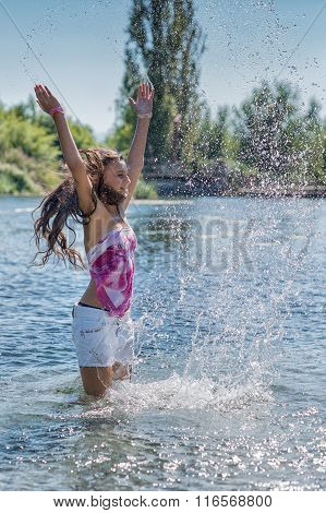 Girl With Long Hair Playing With The Water In The Lake