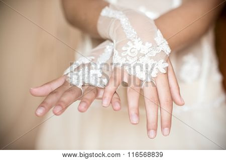 Wedding Hands With White Sleeves In The Foreground
