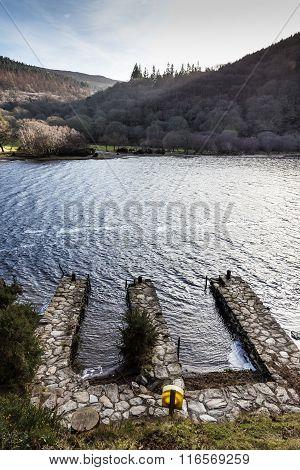 Three Stone Docks In Upper Lake In Glendalough