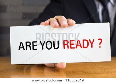 Are You Ready, Message On White Card And Hold By