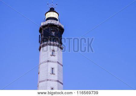 Calais Lighthouse against blue sky. Calais Nord-Pas-de-Calais-Picardy France.