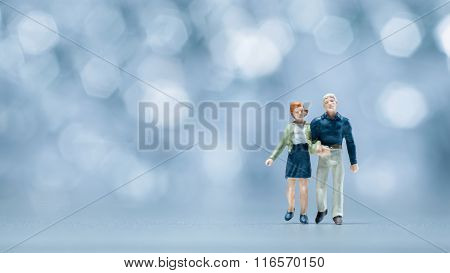 Miniature people - a couple walking