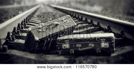 The Black-and-white Image Of Suitcases On Railway Rails.
