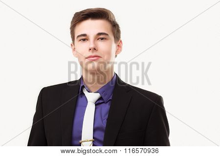 Close-up Portrait Of Young Business Man Wearing Suit And Tie