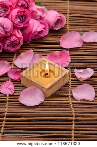 Lying down Pink rose, Petals and candle on mat