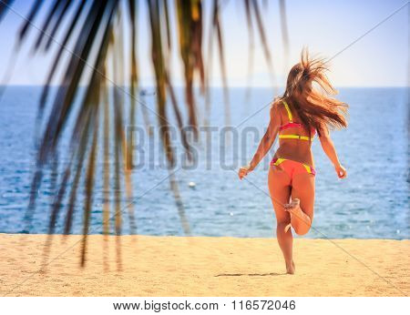 Blonde Slim Gymnast In Bikini Backside View Runs To Sea