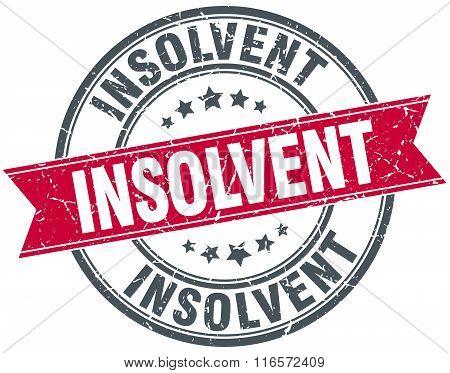 insolvent red round grunge vintage ribbon stamp