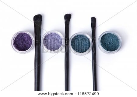 Top view of mineral eye shadows and make-up brushes, isolated on white background