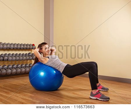 Girl Athlete Trains At A Press Fitball.