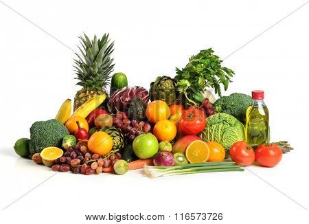 Fresh fruits and vegetables with olive oil on table isolated over white background