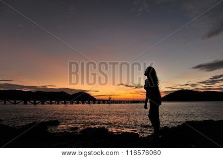 woman on beach in twilight