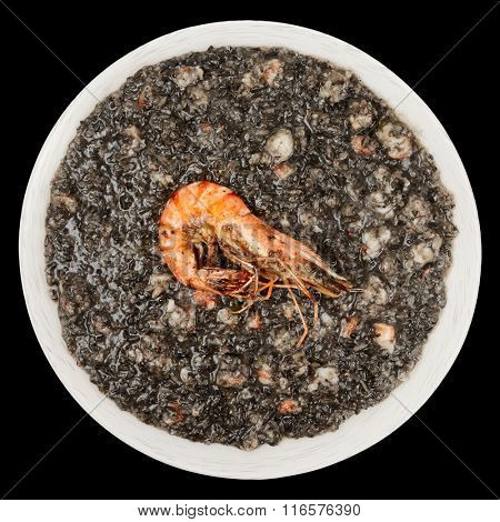 Black squid ink risotto with fried shrimp isolated on black