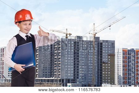 Builder boy in the orange helmet