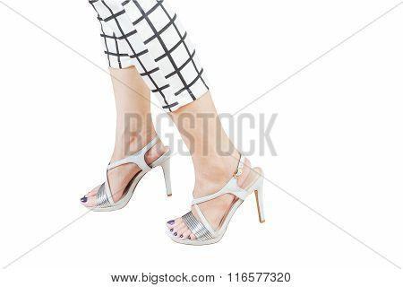 Female Legs Wearing High Heels Isolated On White Background
