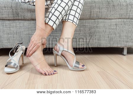Woman Sit On Chair And Female Hand With Foot Pain After, Take Shoes Off