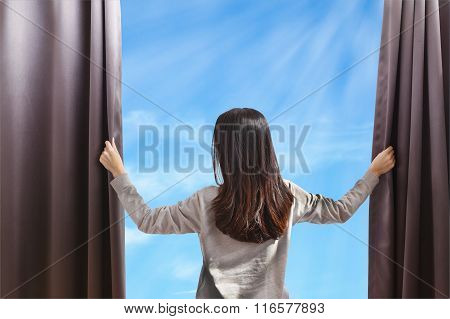 Asian Portrait Beautiful Woman Opening Curtains On Cloud Sky Background