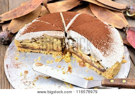 Banoffee pie on wooden table in soft light
