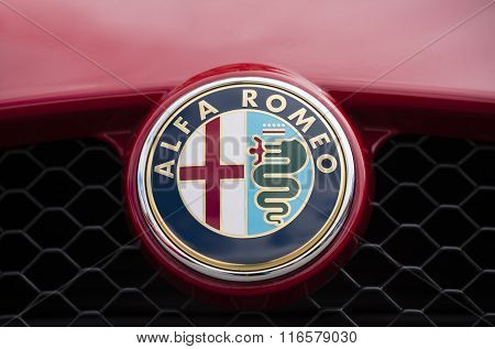Close-up view of the logo on Alfa Romeo
