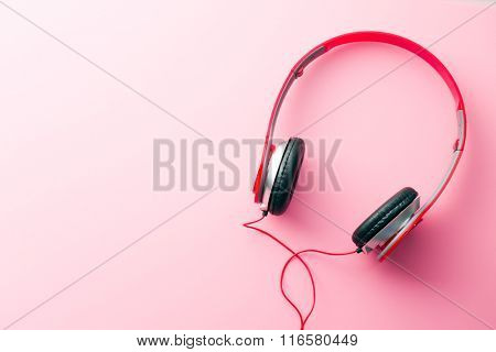the red headphones on pink background