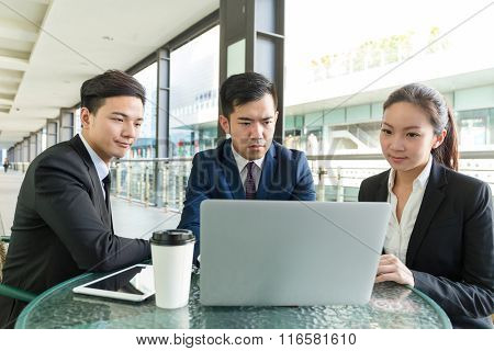 Group of business people discuss about project at coffee shop