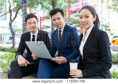 Group of business people use of the notebook computer