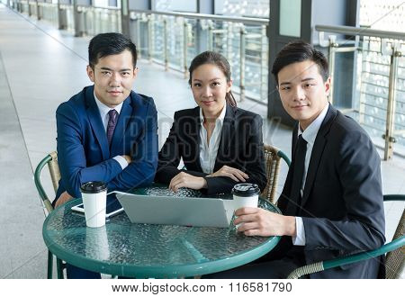 Group of business people use of notebook computer at outdoor