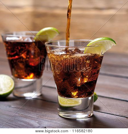 Pour The Rum And Cola Cuba Libre With Lime, Ice