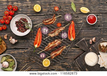 Grilled Bacon On Wooden Skewers With Vegetables