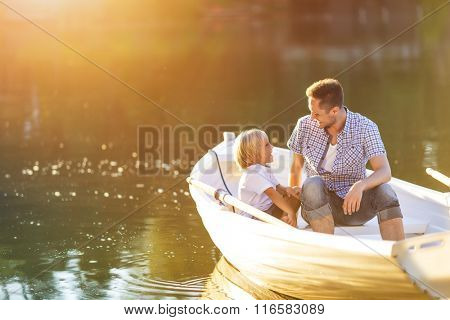 Dad and son in boat on the lake