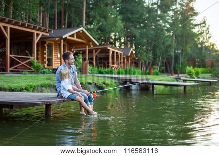 Dad and son fishing on lake