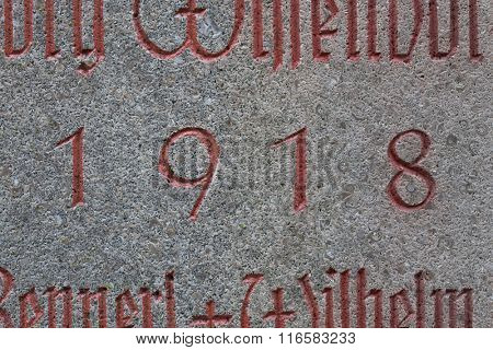 Year 1918 carved in stone. The years of World War I.