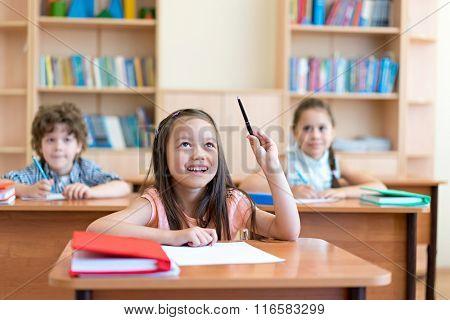 Young pupils at a school desk