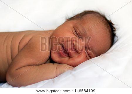 Black Newborn Baby Sleeping Soundly