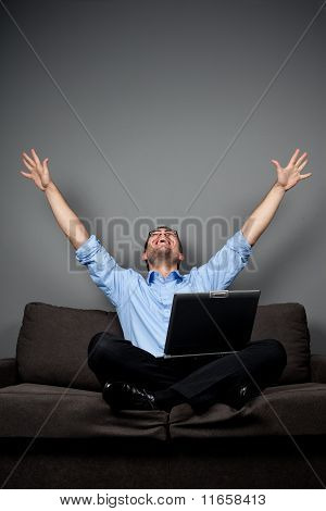 Happy Student On Sofa With Laptop