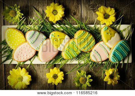 Easter homemade gingerbread cookie over wooden table