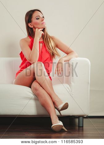 Cute Fashion Woman In Red Shirt On Sofa Couch.