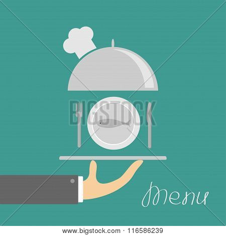 Hand Holding Silver Platter Cloche With Chefs Hat And Plate Fish, Fork, Knife. Menu Card. Green Back