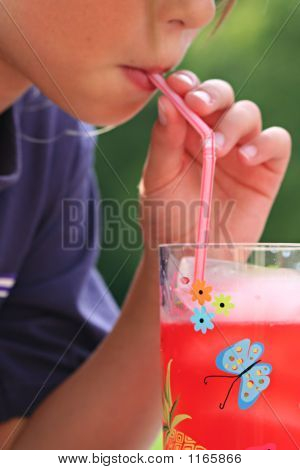 Young Girl Drinking Through Straw
