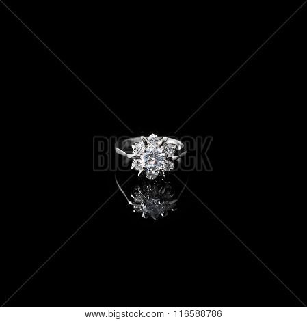 Luxury jewellery. White gold or silver ring with diamonds. Selective focus