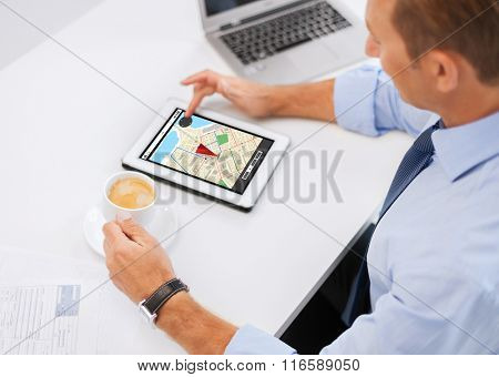 businessman with tablet pc and coffee in office